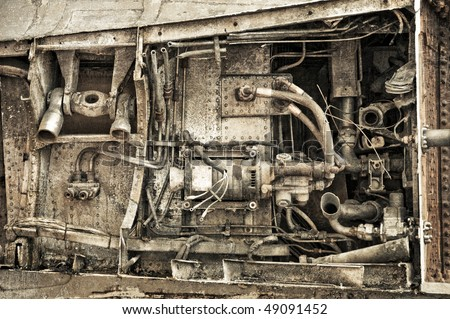 grunged rusty mechanical parts used in the aviation industry - stock photo