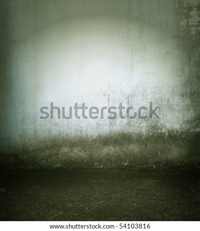 Grungy and dim wall and floor - stock photo