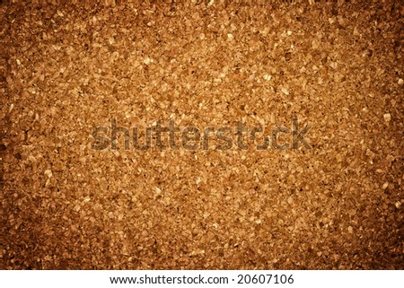 Grungy background: brown corkboard - stock photo