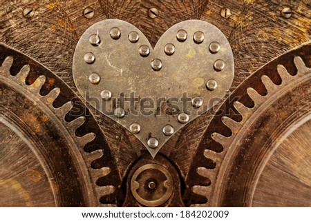 Grungy background with a metallic heart and rivets - stock photo