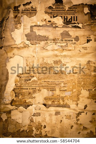 Grungy background with old yellowed Soviet newspaper fragments - stock photo