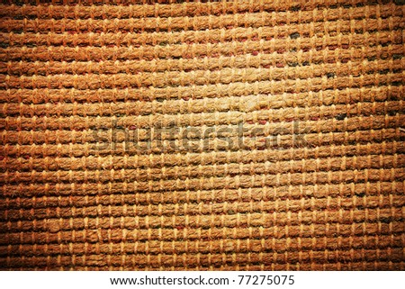 Grungy carpet texture with vignette - stock photo