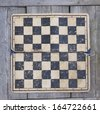 Grungy chessboard stained background - stock photo