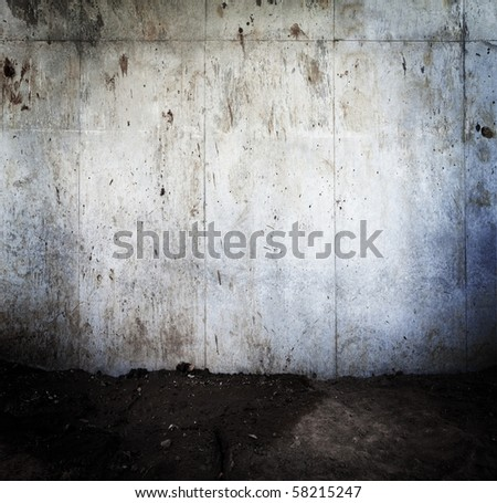 Grungy concrete wall and soil ground - stock photo