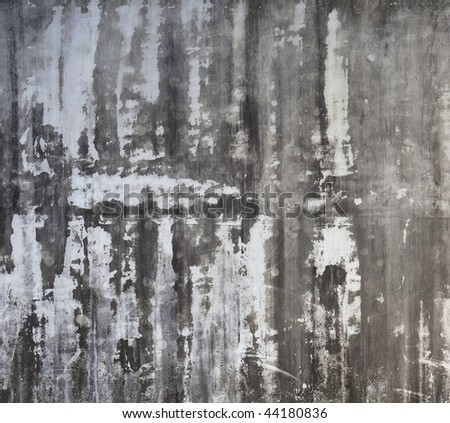 Grungy concrete wall with white streaks