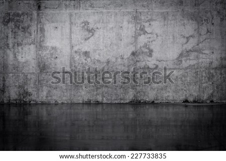Grungy dark concrete wall and wet floor - stock photo