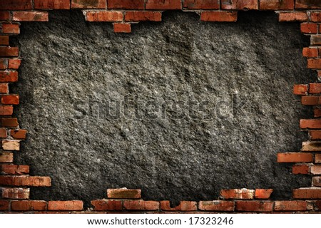 Grungy dark gray concrete wall in red brick frame conceptual background texture. Isolated with clipping path. - stock photo