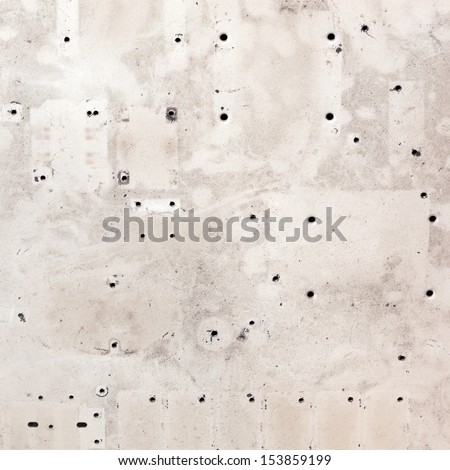 Grungy dirty textured plywood background with many drilled holes - stock photo