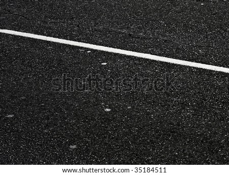 grungy, dirty view of asphalt with distinct white stripe - stock photo