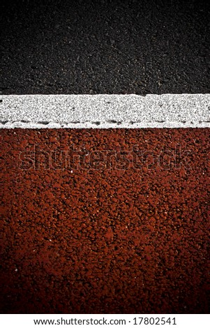 grungy, dirty view of asphalt with red paint and white stripe - stock photo
