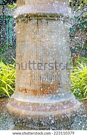Grungy fountain close up with water drops - stock photo