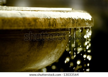 grungy fountain closeup with waterdrops - stock photo