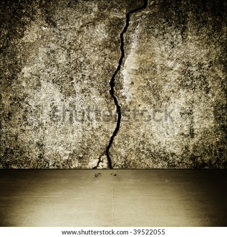 Grungy interior with large crack in the center - stock photo