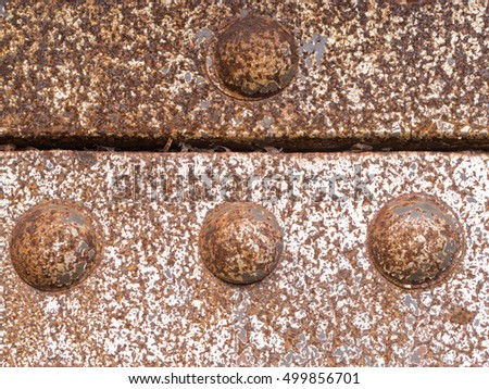 Grungy iron steel construction rusty rivets background texture pattern
