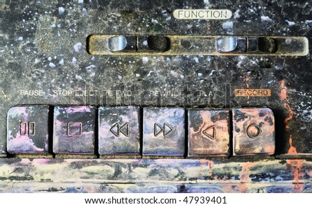 Grungy keyboard of a ghetto blaster, paint splatters - stock photo