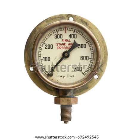 Grungy old brass  air pressure gauge isolated on white background