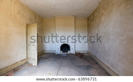Grungy old room with a fire heater - stock photo