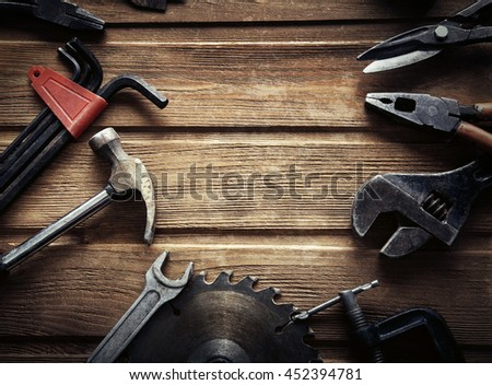 grungy old tools on a wooden background (processing cross-process) - stock photo