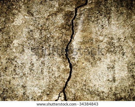 grungy old wall with large cracks