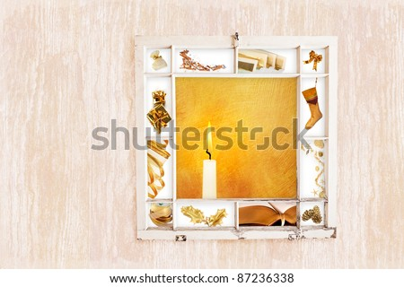 Grungy old window frame with collage of Christmas items on wood grain background. Clipping path for frame - stock photo