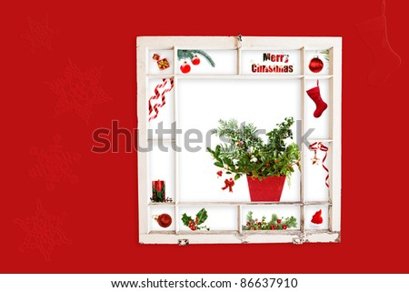Grungy old window frame with collage of red Christmas items. Clipping path for frame - stock photo