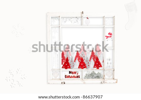 Grungy old window frame with collage of red & white Christmas items. Clipping path for frame - stock photo