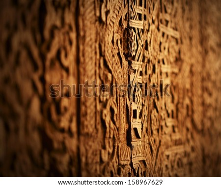 Grungy oriental texture on a wood. Door in one of Uzbekistans' mosque - stock photo