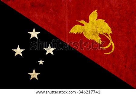 Grungy paper flag of Papua New Guinea - stock photo