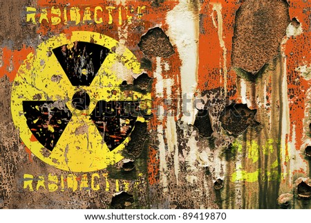 grungy radiation sign on a rusty transport container - stock photo