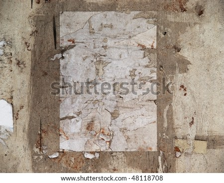 Grungy remnant of a poster - stock photo