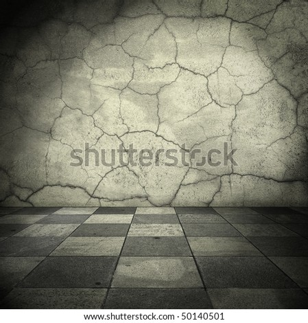 Grungy room with cracked walls - stock photo