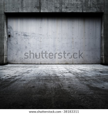 Grungy room with tough and heavy steel door. - stock photo