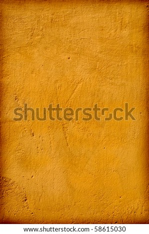 Grungy sand coloured wall with a dark frame. - stock photo