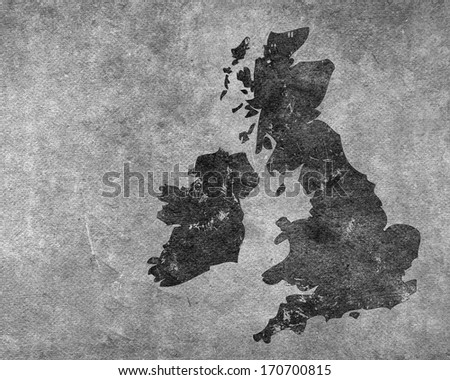 Grungy section of wall overlaid with outline map of UK and Ireland - stock photo