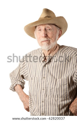 Grungy senior cowboy with a sweat-stained hat - stock photo