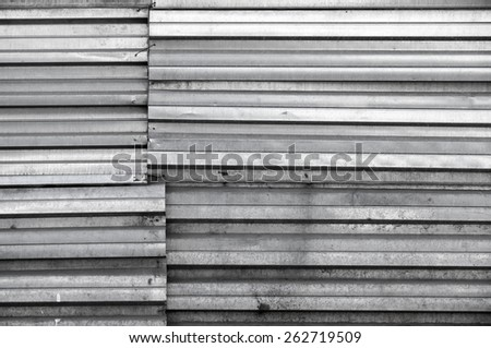 Grungy shining dark gray metal wall, background texture - stock photo