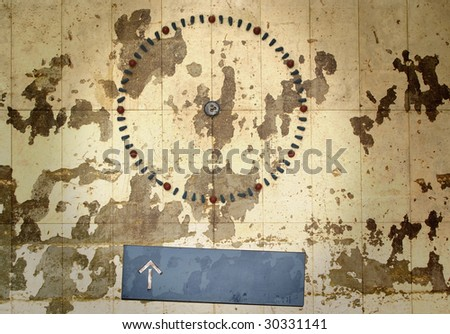 Grungy station clock without hands, blue plate with arrow, free ad space, free copy space, - stock photo