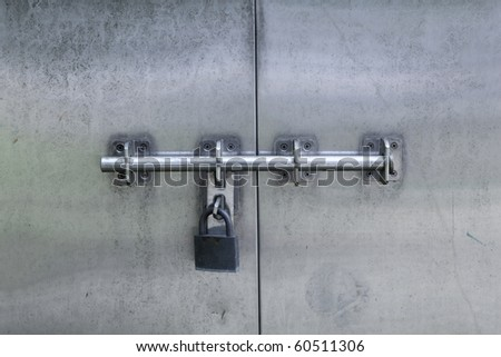 Grungy steel door with lock - stock photo