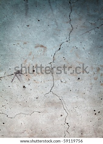 Grungy stone wall with long crack