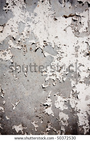 Grungy textured background with peeling gray wall - stock photo