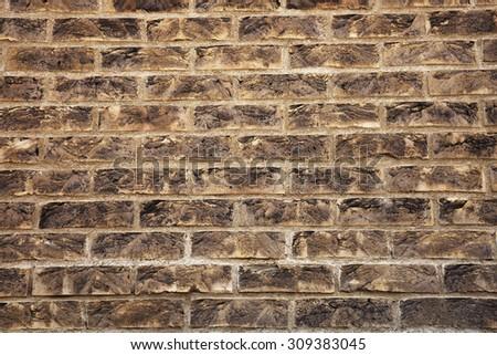 Grungy textured brown brick wall. Brick masonry concept.  - stock photo