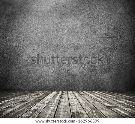 Grungy textured darken room and stone wall with warm brown wooden floor inside old neglected and deserted interior, masonry and carpentry brickwork concept - stock photo