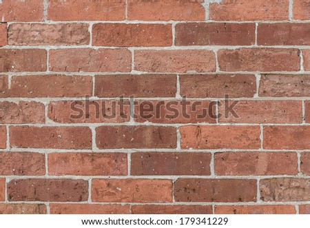 Grungy textured red bricked wall background - stock photo