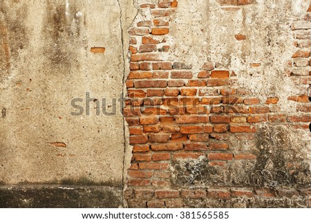 Grungy urban background of a brick old more than 150 years grungy texture grey concrete wall - stock photo