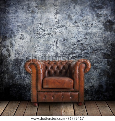 Grungy Wall With Classic Brown Leather Armchair And Old Wood Background