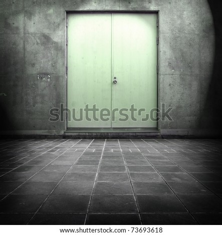 Grungy wall with green door - stock photo