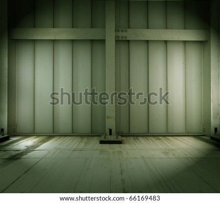 grungy warehouse or factory interior wall and floor. - stock photo