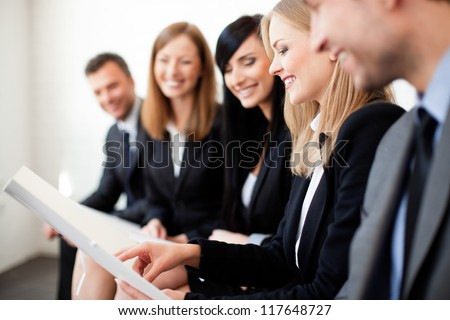 Gruop of business people. Businesswoman explaining