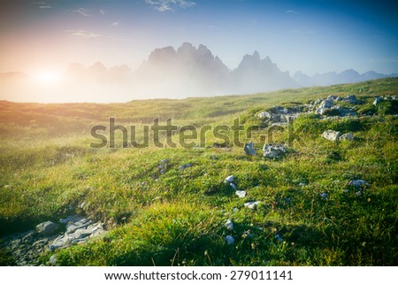 Gruppo Del Cristallo mountain range at foggy summer morning. Dolomites mountains, Italy, Europe. Instagram toning. - stock photo