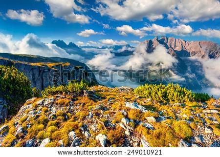 Gruppo Del Cristallo mountain range at foggy summer morning. National Park Tre Cime di Lavaredo. Dolomites, South Tyrol. Location Auronzo, Italy, Europe. - stock photo
